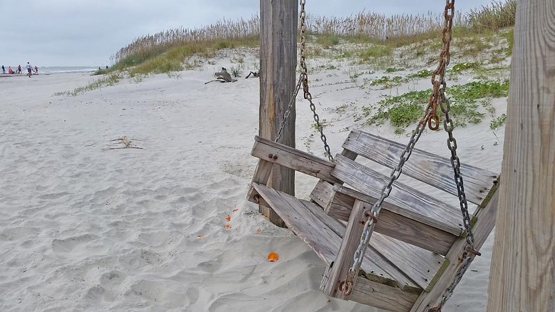 beach swing very close to house.