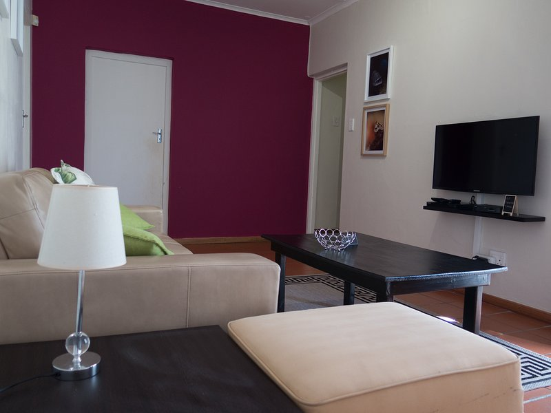 Lounge with 3 seater sofa, chair, coffee table, free Wifi, full DSTV, flatscreen TV and DVD.