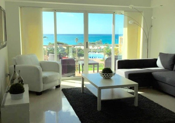 amazing view of the beach and the ocean from the living room and the balcony