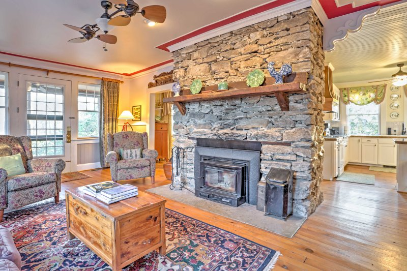 The main floor of the original residence includes a wood stove insert in the living area, a dining room, country kitchen and another full bath.