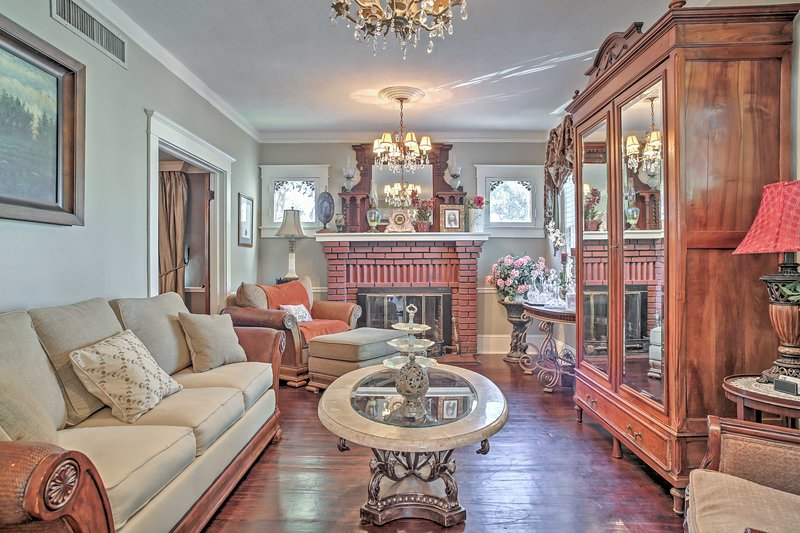 High-end, traditional decor, chandeliers, and hardwood floors line the interior.