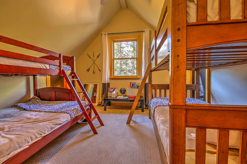 If you're traveling with kids, this bedroom with 2 twin-over-twin bunk beds is perfect for them.