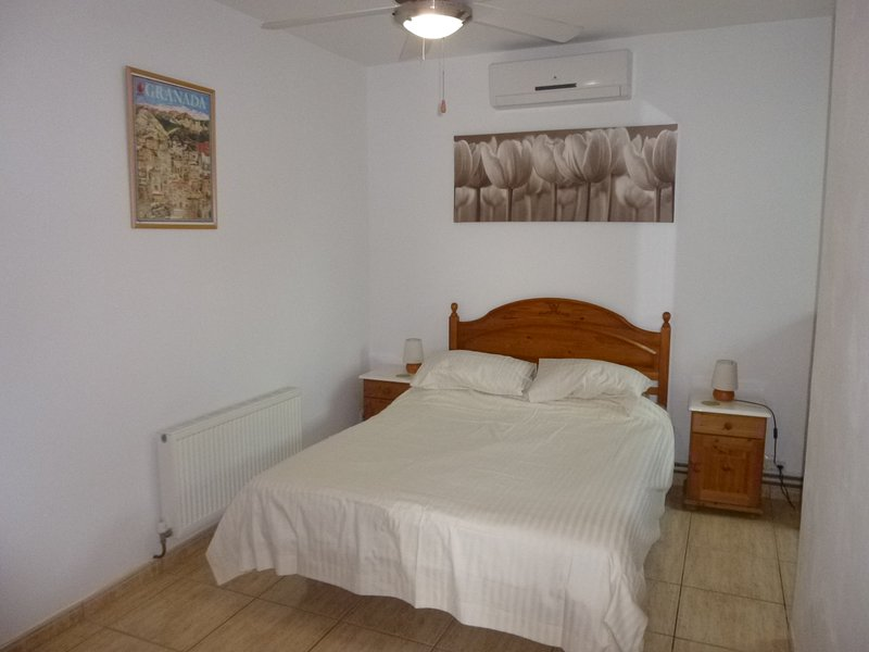 Bedroom in Orange Grove at Finca Arboleda.