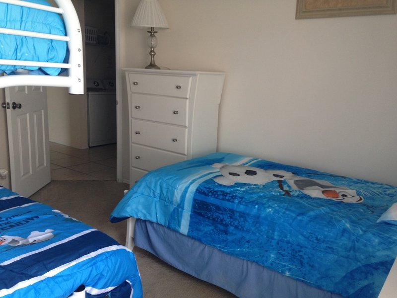 Childrens room sleeps 4 with Triple bunk, Top Bunk and Single bed.
