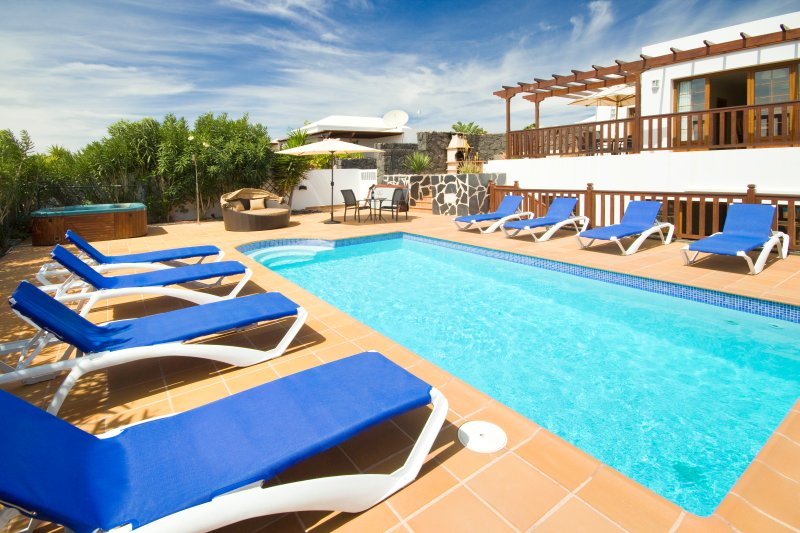 private pool area with 8mx4m swimming pool,hot tub,8 sunloungrs and a luxurious day bed