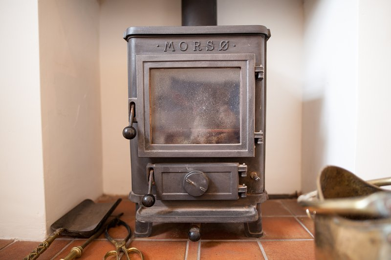 The beautiful log burning stove in the sitting room