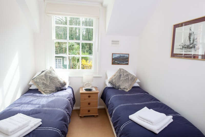 The twin room overlooks the gardens and woodlands, and can be converted to a double-bedded room