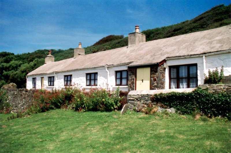 Y Cwm is a short row of ancient fisherman's cottages converted into a single dwelling in a wonderful coastal location