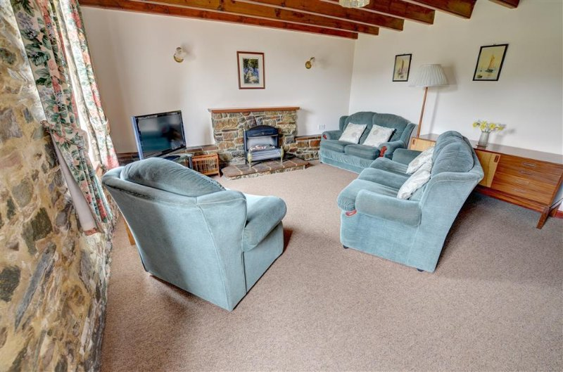 The beamed sitting room has plenty of space