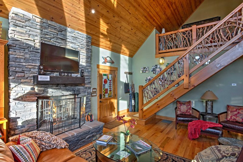 The well-decorated home boasts 1,800 square feet of comfortable living space. Curl up next to the stack stone fireplace during the winter months.
