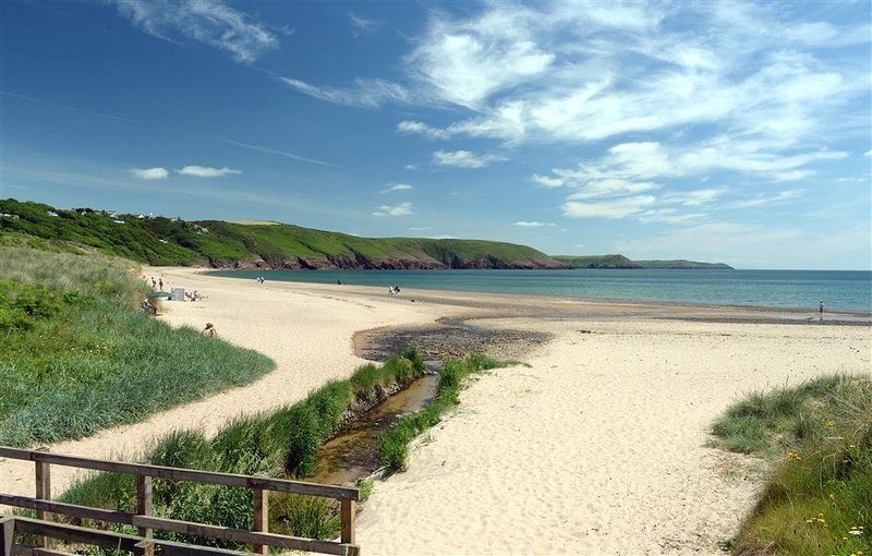 The Boathouse nestles in the dunes on Freshwater East beach, ideal for family breaks.