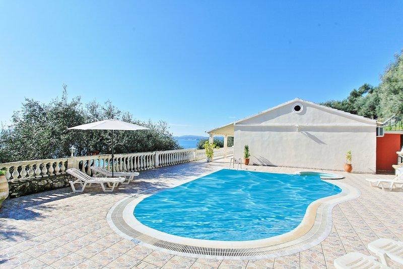 Villa Theodora: Luxury villa with beautiful balconies overlooking the open sea, holiday rental in Nissaki