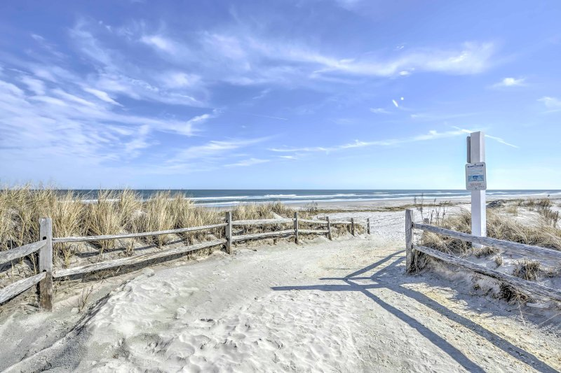 Slip into relaxation when you stay at this 2-bedroom North Wildwood beachfront vacation rental condo!