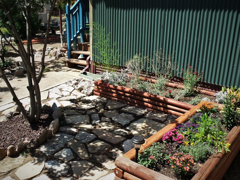 Our recently completed flagstone courtyard and flowers greet you as you enter the bungalow.