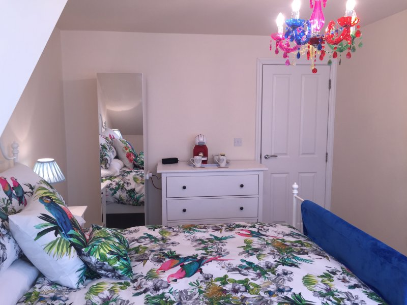 Bedroom with hairdryer &; heated tongs, blue tooth speaker & coffee machine for your comfort.