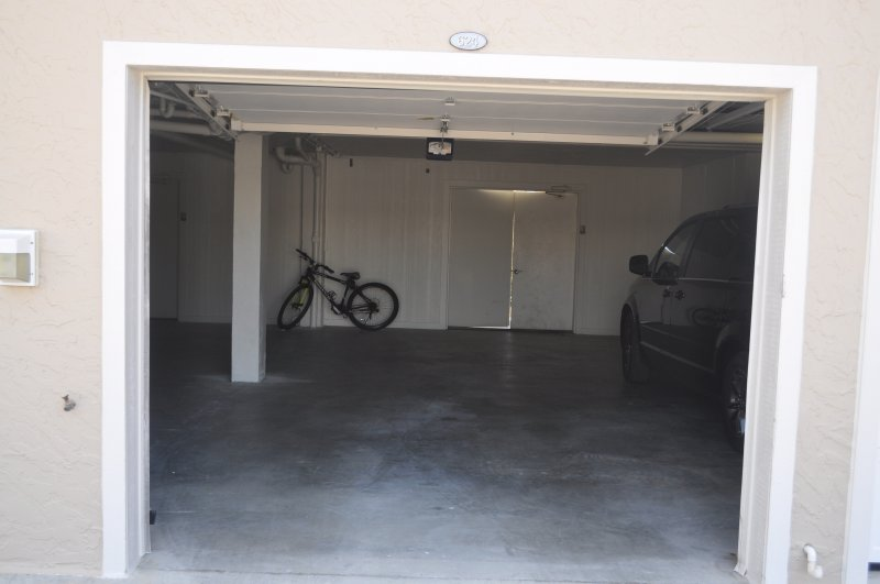 Garage for the unit with another parking spot just across the entry way for your second car.