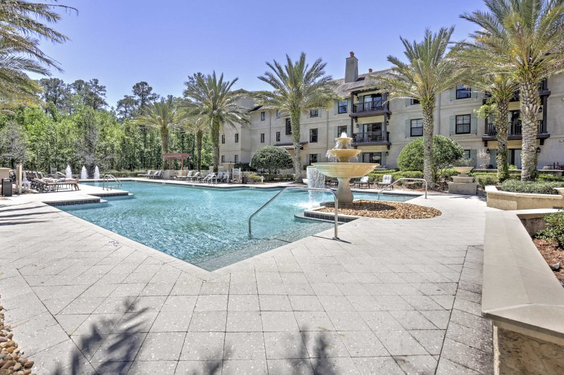 Relish in world-class resort amenities when you stay at this luxurious condo at World Golf Village.