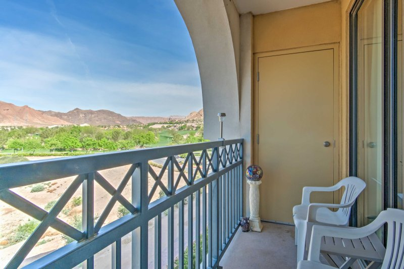 Sip a beverage on the private balcony with views of the mountains.