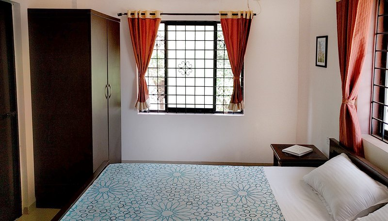 Master bedroom with king size bed with AC