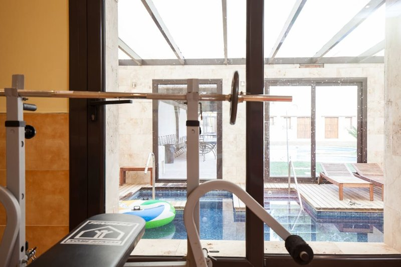 Gym-Fitness with access to the heated indoor pool.