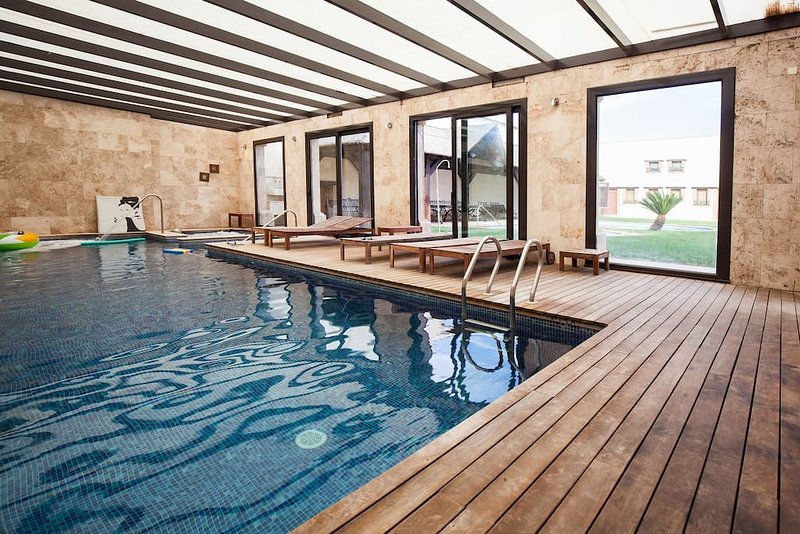 heated pool with Jacuzzi, whirlpool and sauna.