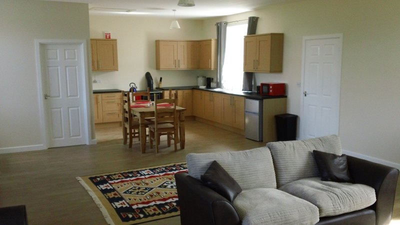 Open plan kitchen.Small fridge freezer, microwave and kitchen utensils are provided.