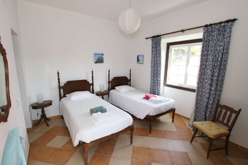 Twin bedroom with ensuite and access to upper balcony with views of the sea