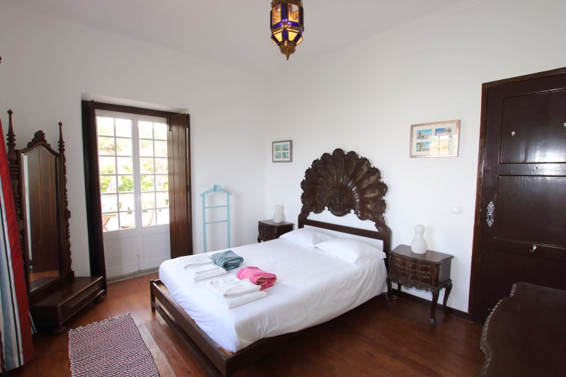 Double bedroom with access to private balcony with views of the garden