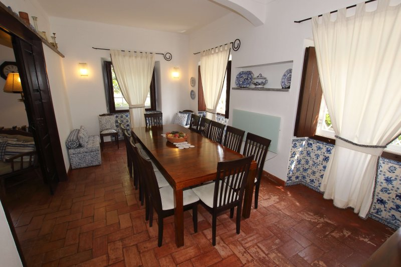 Dining Room, decorated with beautiful Portuguese tiles and seating twelve