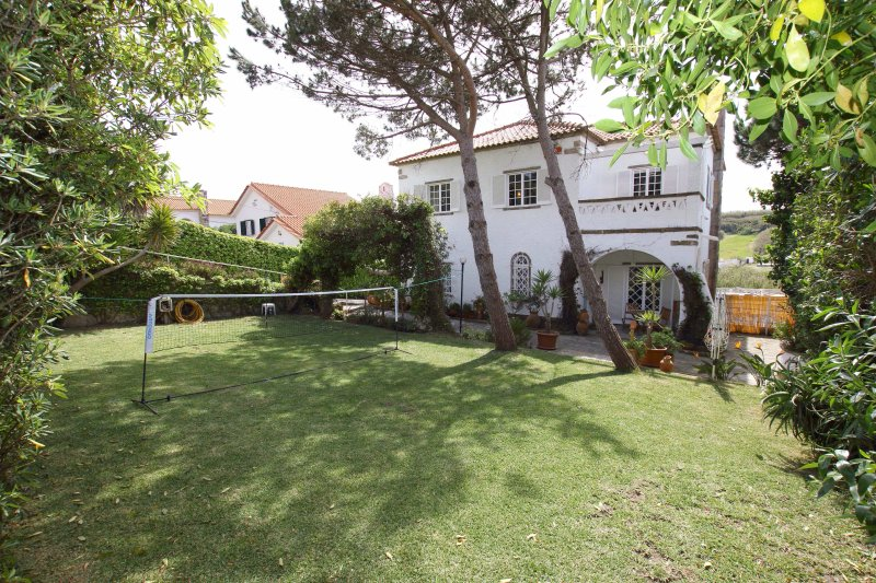 Front entrance and landscaped garden with games to enjoy