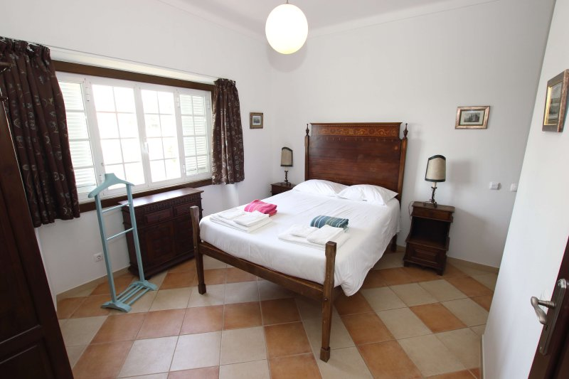 Master bedroom with ensuite and access to upper balcony with views of the sea
