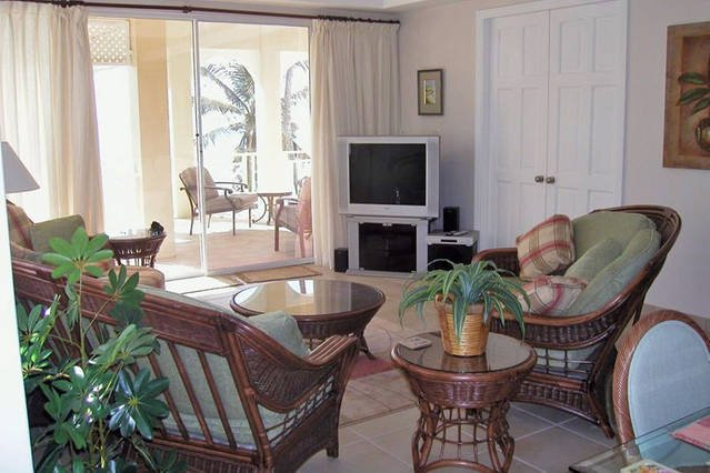 The condo is graced with many tall glass-paneled doors and windows