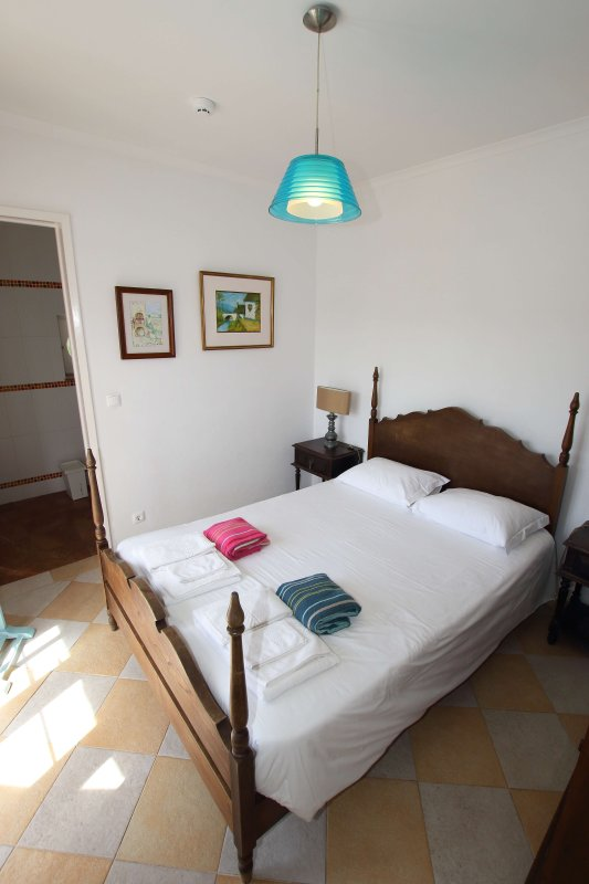 Ground floor double bedroom with ensuite and views of the sea
