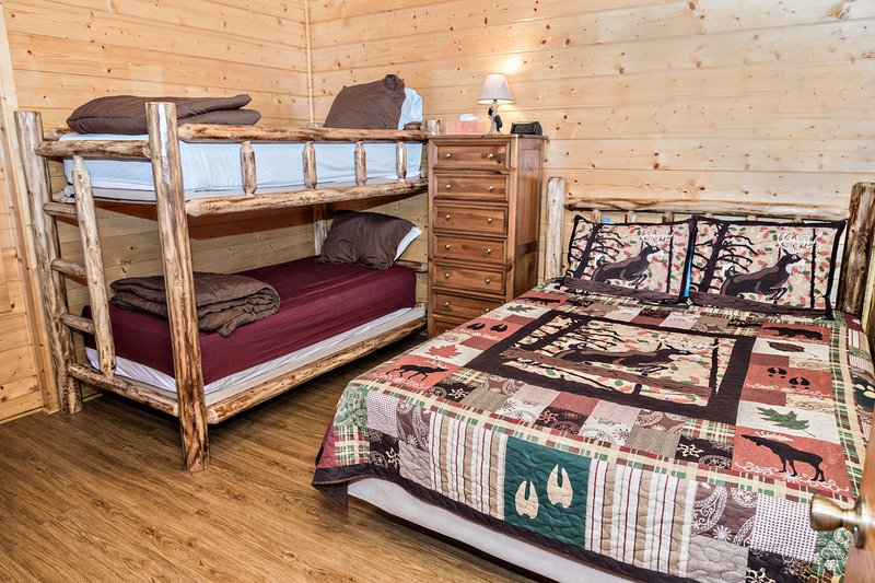 Downstairs bedroom left with twin bunk beds and a queen bed.