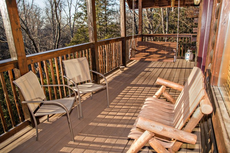 Main level porch with plenty of seating to relax and enjoy the view.