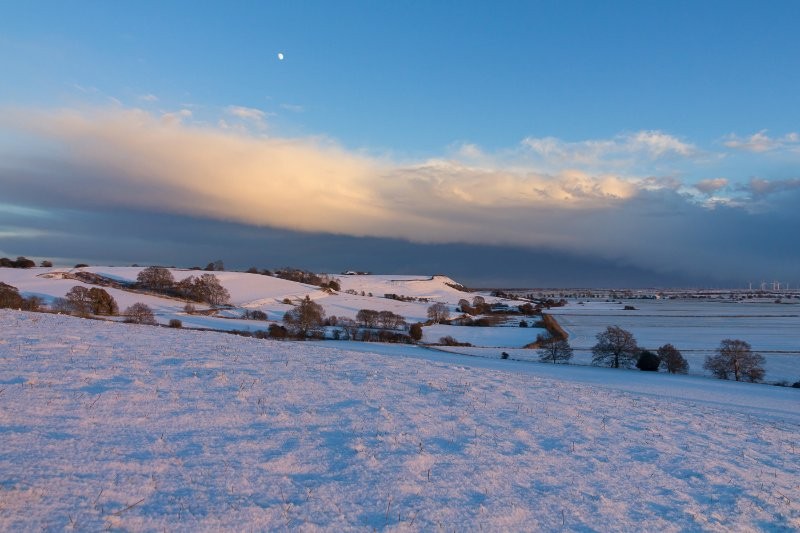 Snowy view of moon rising over Stone Cliff.