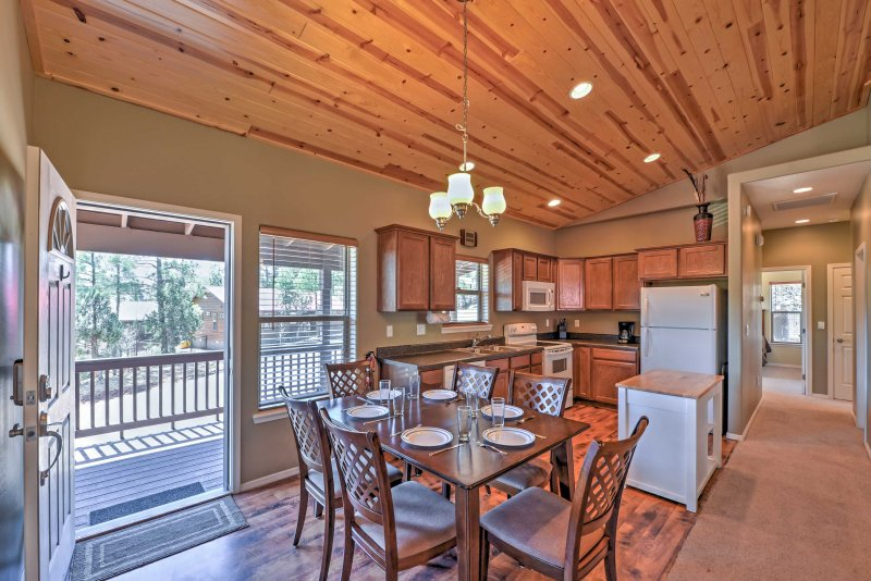 Open up the sliding glass door to let the breeze flow throughout the cabin.