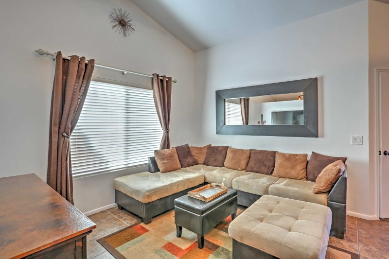 Curl up on the plush sectional sofa in the living area.