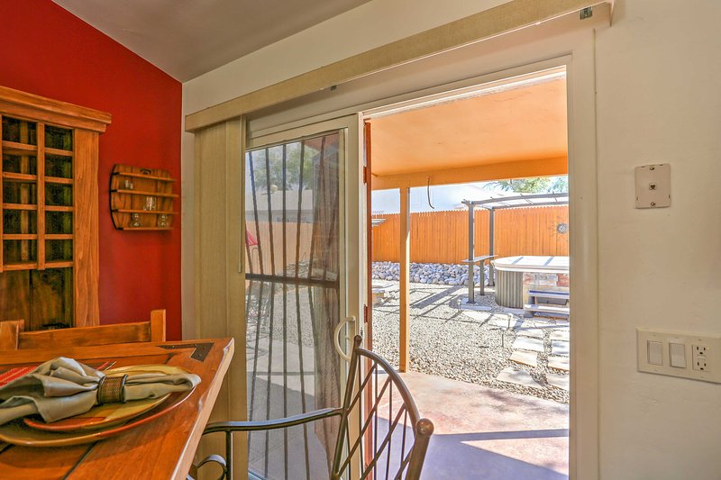 Access the beautiful backyard through the dining area.