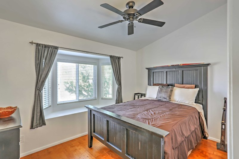 The master bedroom offers a plush queen-sized bed.