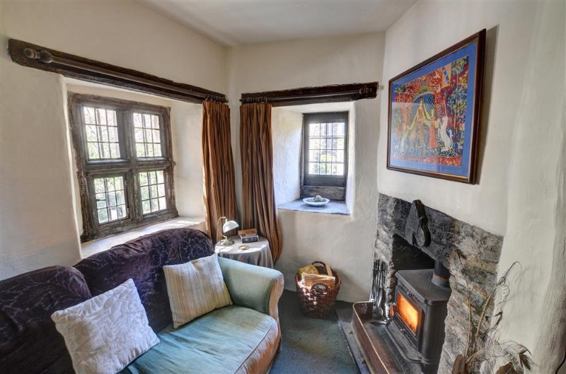 The cottage has a woodburning stove in the small stone fireplace
