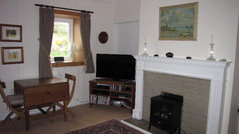 Sala de estar e sala de jantar. TV Video leitor de música .WIFI