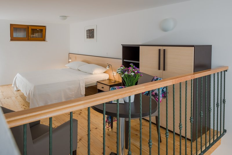 Gallery with double bed