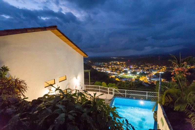 Casa Moreno in the evening with the lights of Quepos below.
