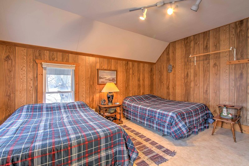 This studio features wood paneling to give it a classic cabin feel.