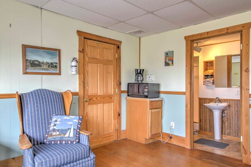 This studio features a microwave and coffee maker for your morning needs.