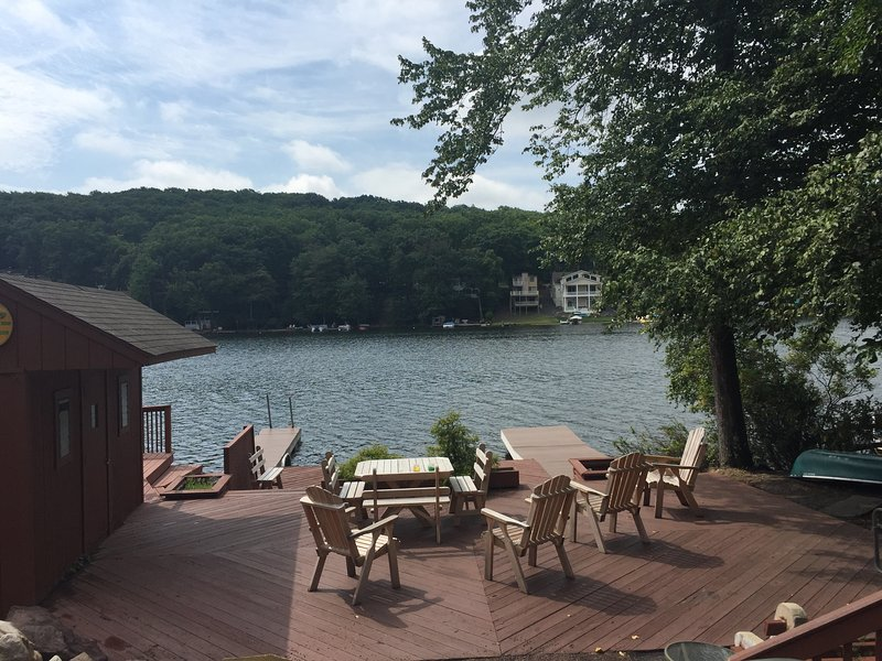 Lake, deck and docks in front of the cottage