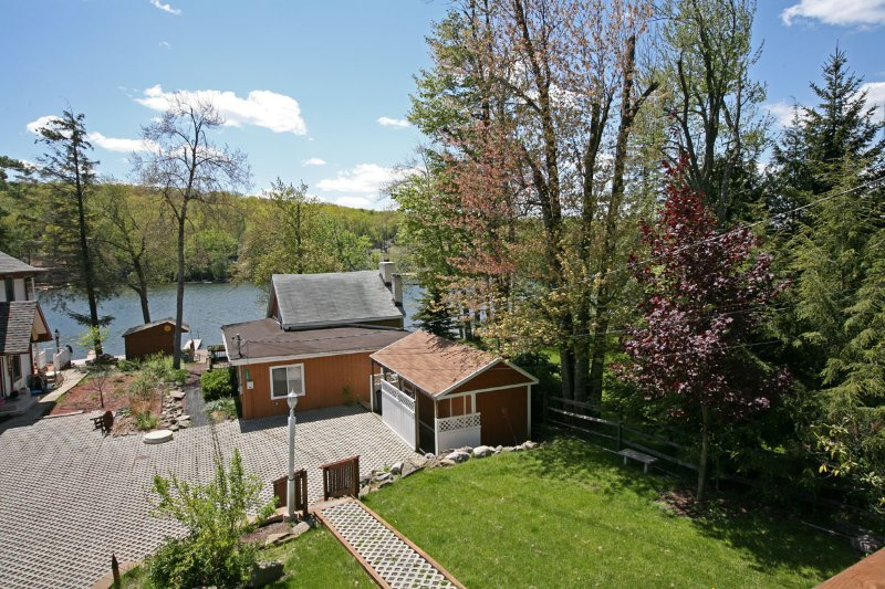 View  of the lake and cottage from deck of larger house