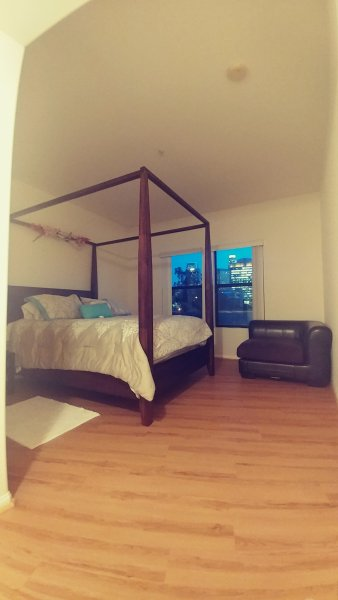 Luxury and comfortable bed with a Downtown LA view