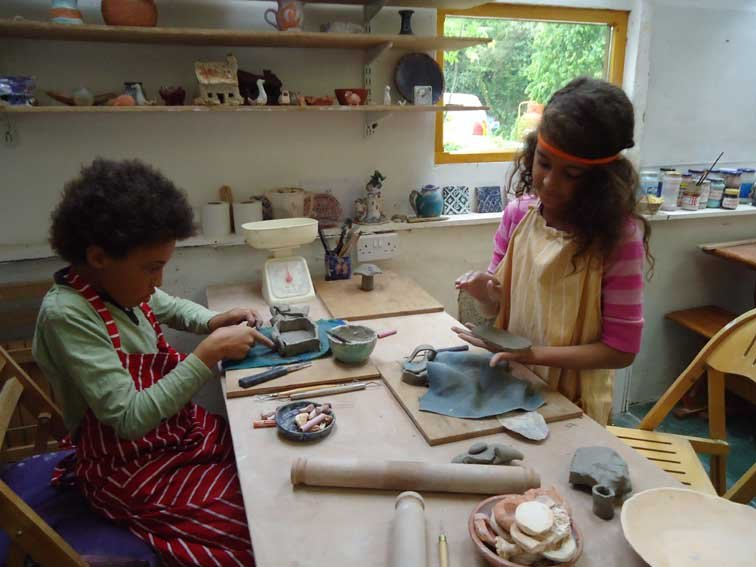 Handbuilding pots in the Pottery workshop...on site